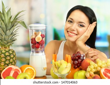 Girl with fresh fruits on room background