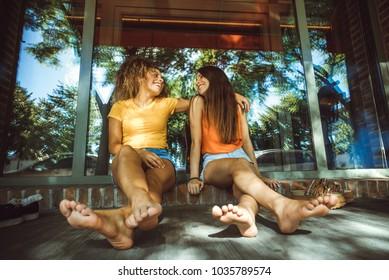 girl friend sitting on the street