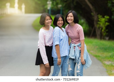 girl friends enjoy look at the camera