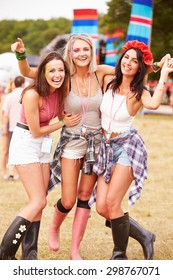 Girl friends hanging out together at a music festival