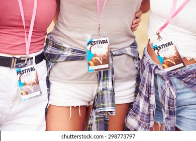 Girl friends at a music festival, crop