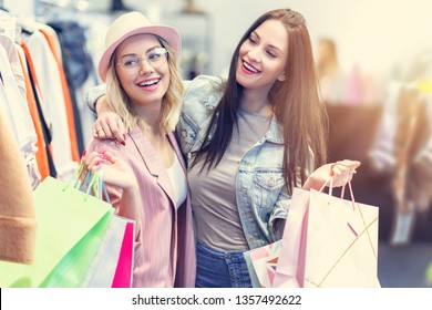 Girl friends shopping for clothes in store