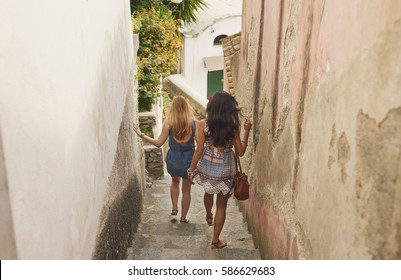 Girl friends travelling in beautiful Italy relaxing summer vacation exploring to discover carefree lifestyle