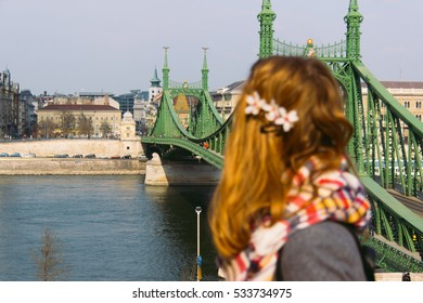 Girl in front of a bridge in Budapest