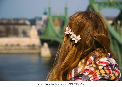 Girl in front of a bridge in Budapest with background out of focus