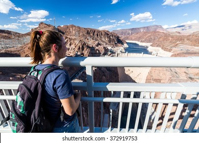Girl in front of Hoover Dam and Lake Mead