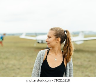 Girl in front of sport plane