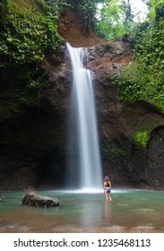 Girl In Front Of A Waterfall in Bali