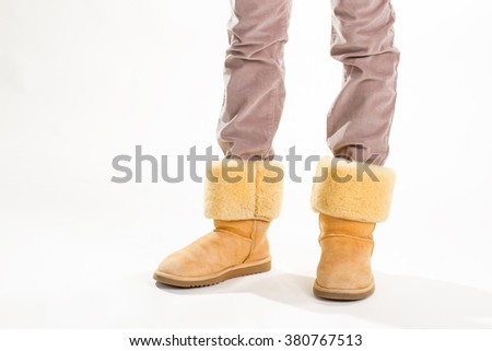 Girl Funny Yellow Winter Australian Boots Stock Photo (Edit
