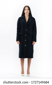 girl in a fur coat on a white background for a catalog