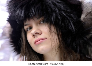 girl with fur hat. beauty, macro