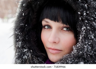 girl in fur hood and snow