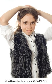 girl in a fur vest posing isolated on white background