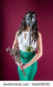 girl in a gas mask. against viruses. epidemic. radiation. protection against bacteria. coronavirus.