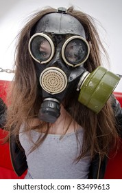 The girl in a gas mask. Bad ecology concept
