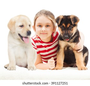 girl with a German Shepherd and Labrador puppy