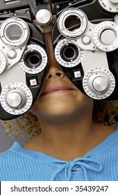 girl getting eyes testing