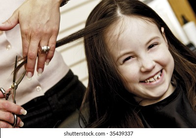 girl getting hair cut