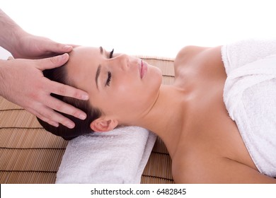 girl getting head massage at the spa center