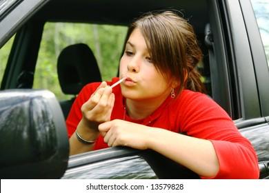 Girl getting lips gloss
