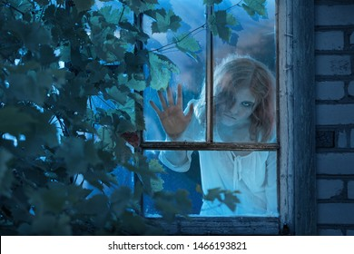 girl ghost in the old window
