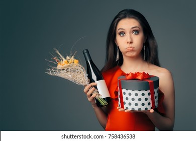 Girl with Gift Box, Wine Bottle and Flower Bouquet Ready for Party. Funny woman celebrating a special occasion