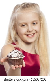 Girl giving a cake. Isolated on white background.