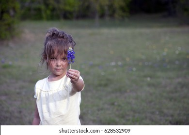Girl giving a flower