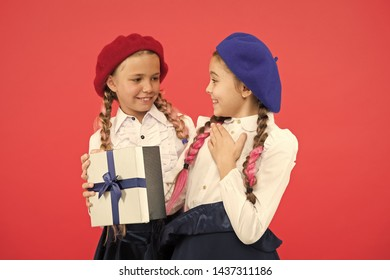 Girl giving gift box to friend. Girls friends celebrate holiday. Children formal wear with gift box. Open gift now. Friendship concept. Birthday present. Shopping and holidays. For my dear friend.