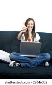 Girl giving the thumbs up on a couch
