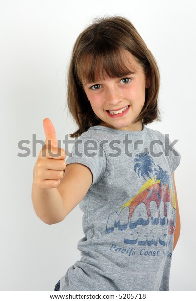 Girl giving the thumbs up sign