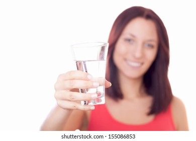 Girl with glass of water. Focus on glass