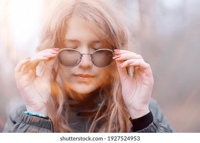 girl glasses autumn portrait, an adult woman glamorous autumn look