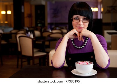 girl in glasses with coffe