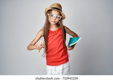 a girl with glasses and a hat.