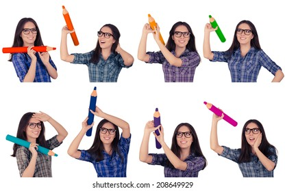 Girl with Glasses Holding Giant Pencils in Multiple Colors - Girl wearing glasses holds giant colored pencils isolated on white background