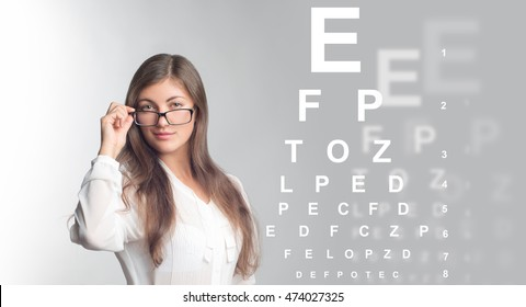 The girl in glasses on a black background