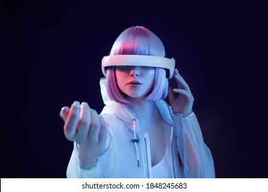 Girl in glasses of virtual reality. Augmented reality game, future technology, AI concept. VR. Neon light.