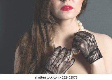 The girl in gloves and necklace