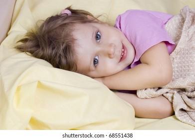 Girl go to sleep in bed