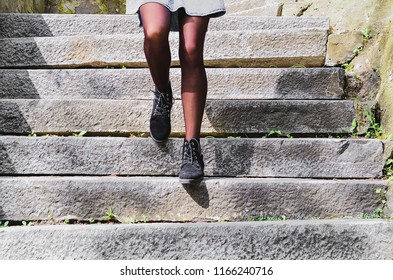 the girl goes down the stairs of her feet