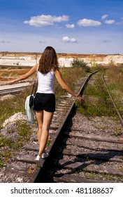 The girl goes on rails, maintaining a balance poised