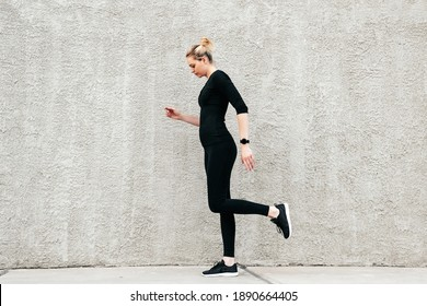 Girl goes in for sports on the street, Running on the spot, Blac