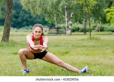 The girl goes in for sports in the park
