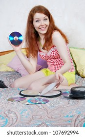 The girl goes through wheels on the bed