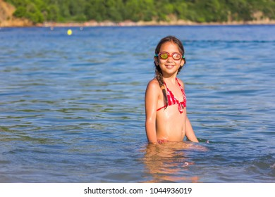 Girl with gogles in the sea
