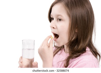 The girl is going to eat a tablet and to wash down with its water