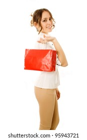 Girl going home carrying shopping bags on her shoulder with happy expression
