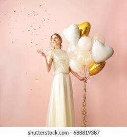 Girl and gold balloons in the form of hearts