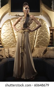 A girl in a gold dress